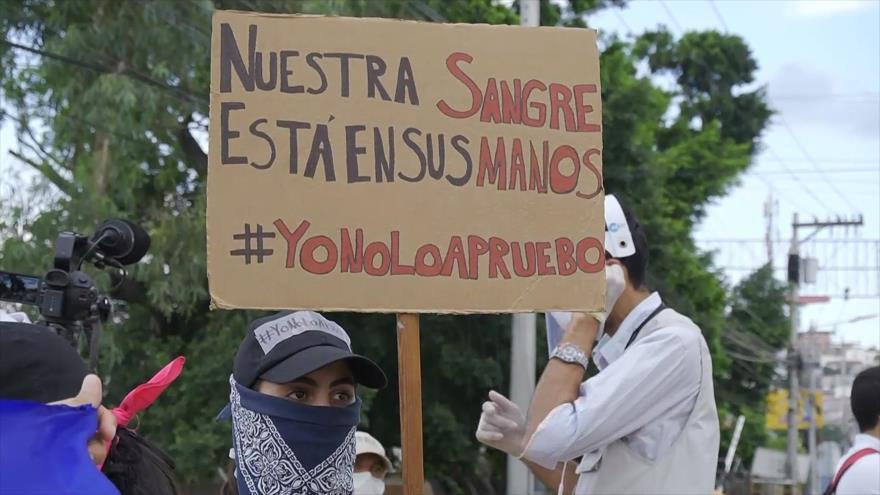 Hondureños protestan contra el presidente Juan Orlando Hernández