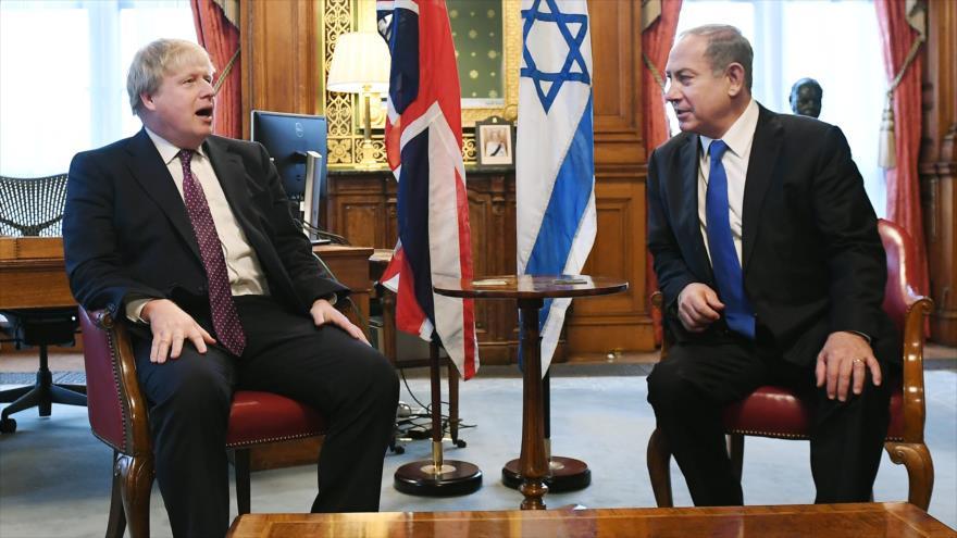 El primer ministro británico, Boris Johnson (izda.), reunido con su homólogo israelí, Benjamín Netanyahu, en Londres, la capital de Reino Unido.