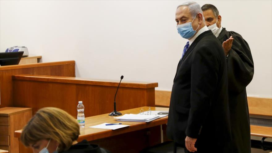 El primer ministro israelí, Benjamín Netanyahu, aparece ante el tribunal de Al-Quds en el 1.º día de su juicio por corrupción, 24 de mayo de 2020. (Foto: AFP)
