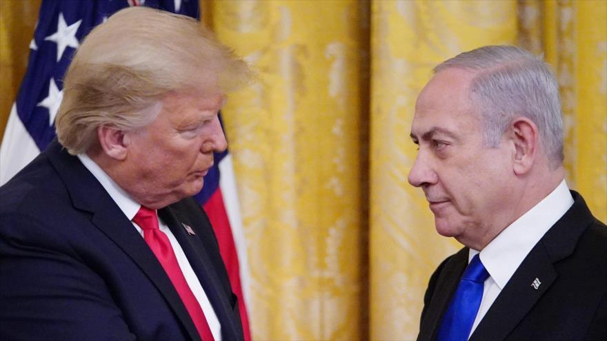 El premier israelí, Benjamín Netanyahu (dcha.), y el presidente de EE.UU., Donald Trump, en un acto en Washington, 28 de enero de 2020. (Foto: AFP)