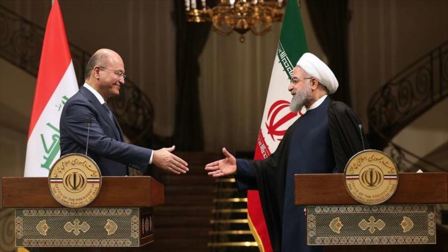 El presidente iraní, Hasan Rohani (dcha.), y su homólogo iraquí, Barham Salih, en una rueda de prensa en Teherán, 17 de noviembre de 2018. (Foto: IRNA)
