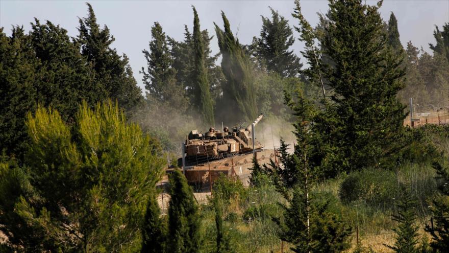 Un tanque del ejército israelí cerca de la zona fronteriza con El Líbano en la parte norteña de Palestina ocupada, 2 de junio de 2020. (Foto: AFP)