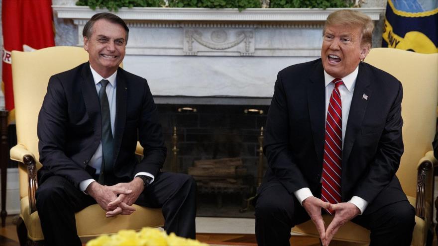 El presidente de EE.UU., Donald Trump (decha.), y el presidente de Brasil, Jair Bolsonaro, en la Casa Blanca, EE.UU., 19 de marzo de 2019.
