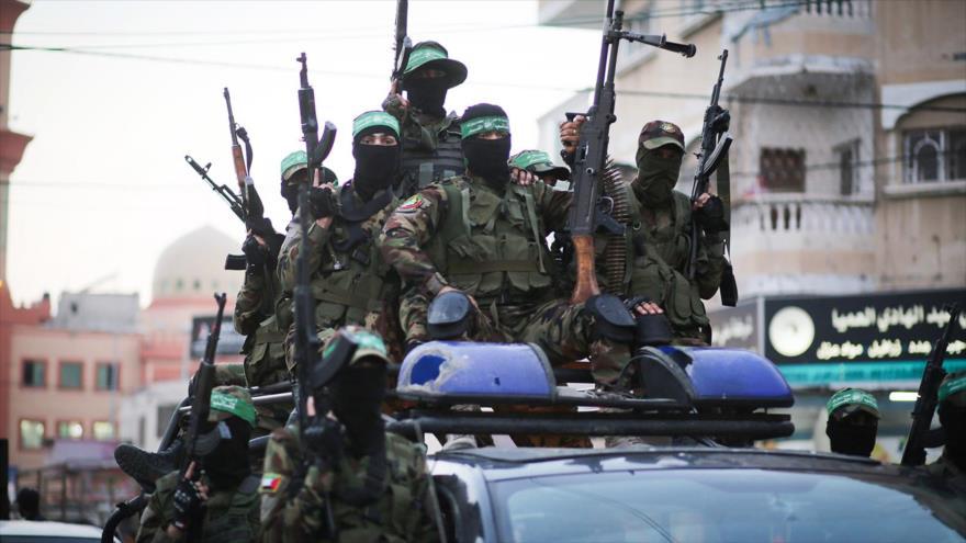 Miembros de las Brigadas de Ezzedin Al-Qassam, brazo militar de HAMAS, en un desfile en la ciudad de Gaza, 25 de julio de 2019.