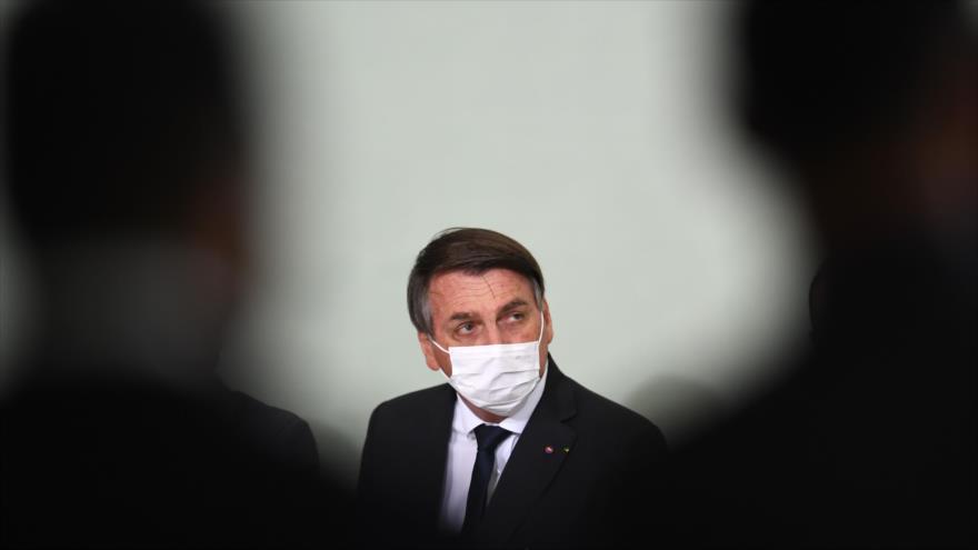 El presidente brasileño, Jair Bolsonaro, asiste a una reunión en Brasilia, la capital, 25 de agosto de 2020. (Foto: AFP)