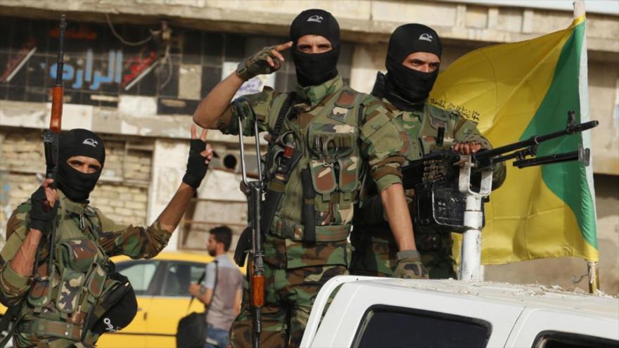 Fuerzas del Movimiento de Resistencia Islámica de Irak (Kataeb Hezbolá).