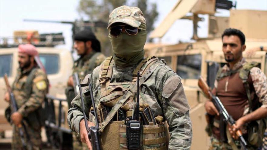 Integrantes de las Fuerzas Democráticas Sirias (FDS), respaldadas por EE.UU., en Deir Ezzor, mayo de 2018.