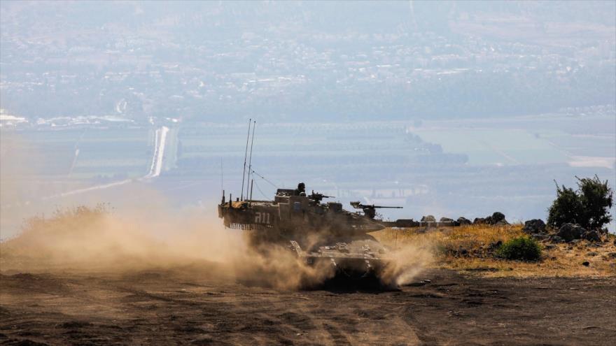 Un tanque Merkava del Ejército israelí, desplegado en los ocupados altos del Golán en el suroeste de Siria, 24 de junio de 2020. (Foto: AFP)