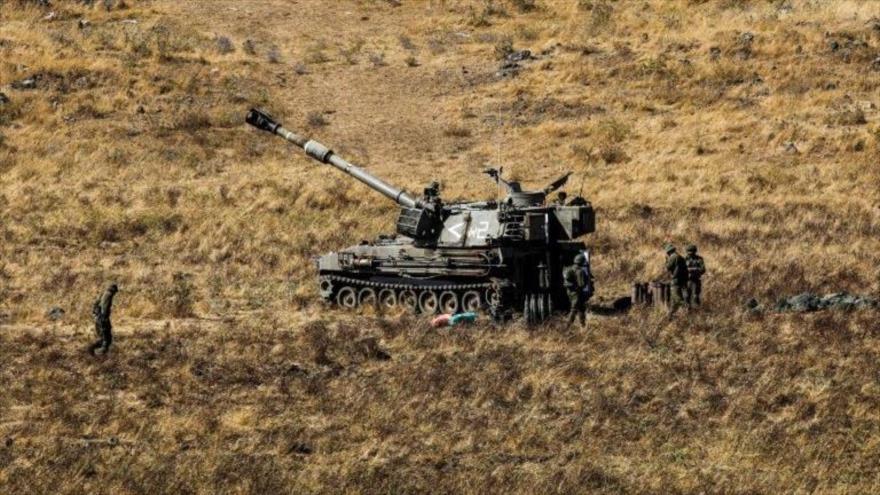 Soldados y un tanque del régimen de Israel durante un ejercicio militar en los altos del Golán, 24 de junio de 2020. (Foto: AFP)