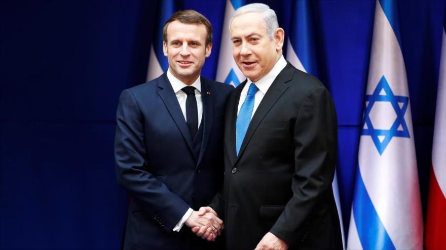 El presidente francés, Emmanuel Macron (izda.) y el premier israelí, Benjamín Netanyahu, en Al-Quds (Jerusalén), 22 de enero de 2020. (Foto: AFP)
