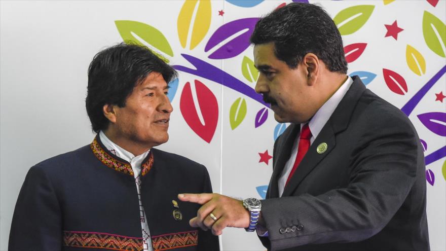 El expresidente boliviano Evo Morales (izda.) y el presidente venezolano Nicolás Maduro, isla Margarita (Venezuela), 17 de septiembre de 2016. (Foto: AFP)