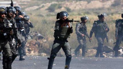 Fuerzas israelíes tirotean a 3 jóvenes palestinos en Cisjordania