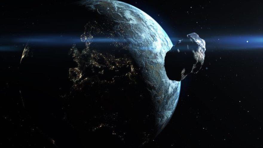 Imagen representativa de un asteroide acercándose a la Tierra.