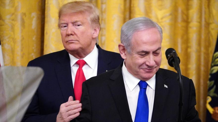 El presidente de EE.UU., Donald Trump (izda.), y el premier israelí, Benjamín Netanyahu, en un acto en la Casa Blanca, 28 de enero de 2020. (Foto: AFP)