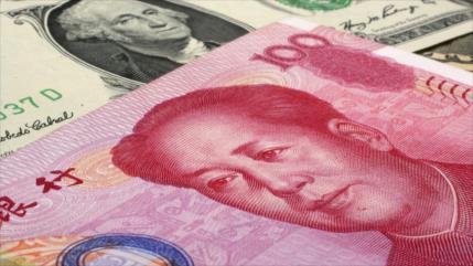 Crisis de EEUU le da al yuan oportunidad para imponerse ante dólar