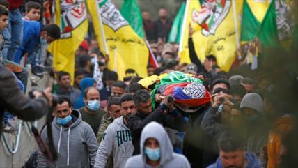 Centenares de palestinos dicen adiós a menor asesinado por Israel