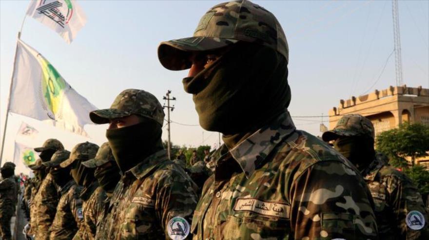 Combatientes de las Unidades de Movilización Popular (Al-Hashad Al-Shabi, en árabe) en un desfile. (Foto: Reuters)