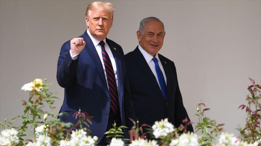 El presidente de EE.UU., Donald Trump, y el premier israelí, Benjamín Netanyahu, tras la firma de los acuerdos de normalización de lazos, septiembre de 2020. (Foto: AFP)