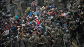 Biden afronta 1.º reto con caravana de refugiados centroamericanos