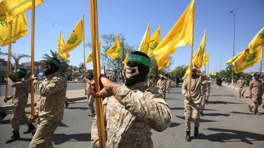 Combatientes del Movimiento Hezbolá al-Nuyaba marchan durante un desfile militar en Bagdad, capital iraquí, 31 de mayo de 2019. (Foto: AFP)