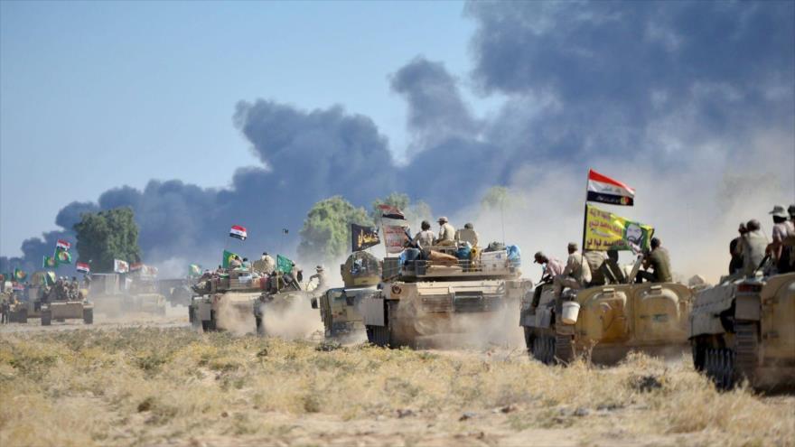 Fuerzas del Ejército y las Al-Hashad Al-Shabi de Irak en las afueras de la ciudad de Al-Hawija (norte iraquí), 4 de octubre de 2017.