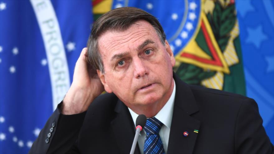 El presidente brasileño, Jair Bolsonaro, durante una conferencia de prensa en el Palacio Planalto de Brasilia, 5 de febrero de 2021. (Foto: AFP)