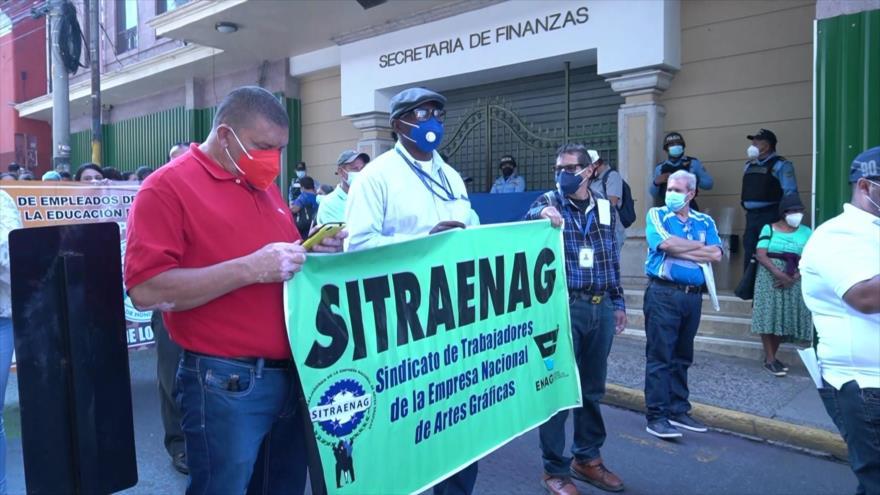 Trabajadores hondureños protestan para exigir derechos salariales