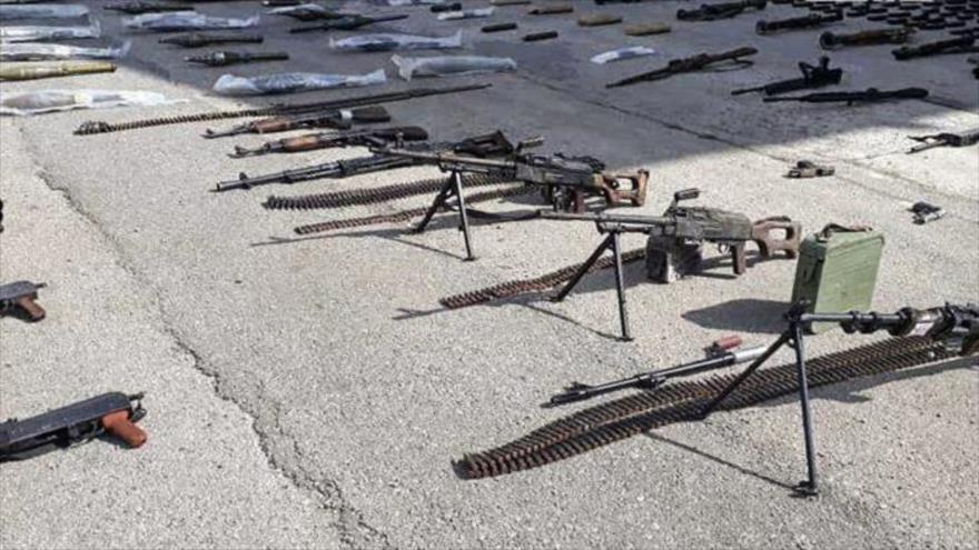 Armas y municiones dejadas por terroristas e incautadas por el Ejército sirio en Homs, 21 de marzo de 2019. (Foto: SANA)