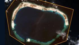 Foto satelital revela que China construye bases en isla de Spratly