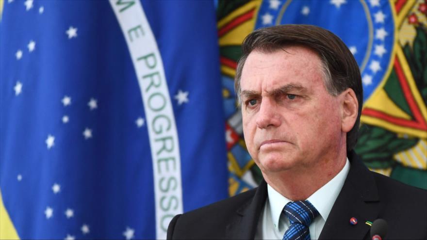 Presidente de Brasil, Jair Bolsonaro, habla en una conferencia de prensa en Brasilia (capital), 5 de febrero de 2021. (Foto: AFP)