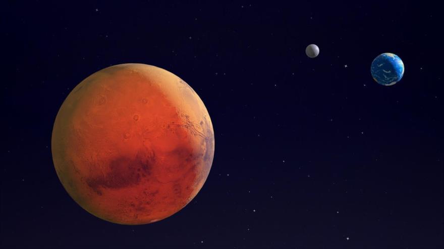 Imagen ilustrada de la NASA que muestra al planeta Marte, la Tierra y la Luna.(Foto: Getty Images)