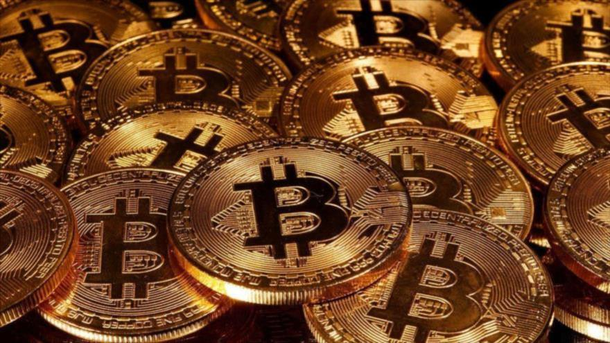 Bitcóinbate un nuevo récord; alcanza los 60 000 dólares por unidad | HISPANTV
