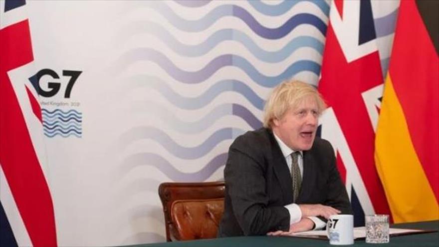 El premier británico, Boris Johnson, interviene en una reunión virtual del G7, 19 de marzo de 2021. (Foto: AFP)