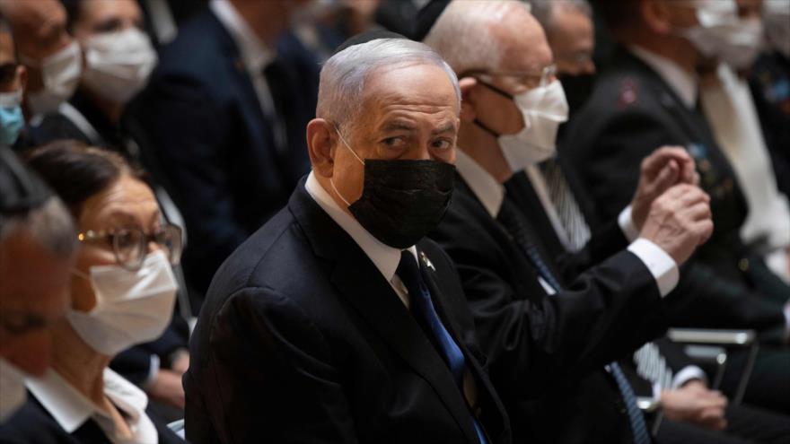 El primer ministro israelí, Benjamín Netanyahu, (c) en un acto celebrado en Al-Quds (Jerusalén), 14 de abril de 2021. (Foto: AFP)