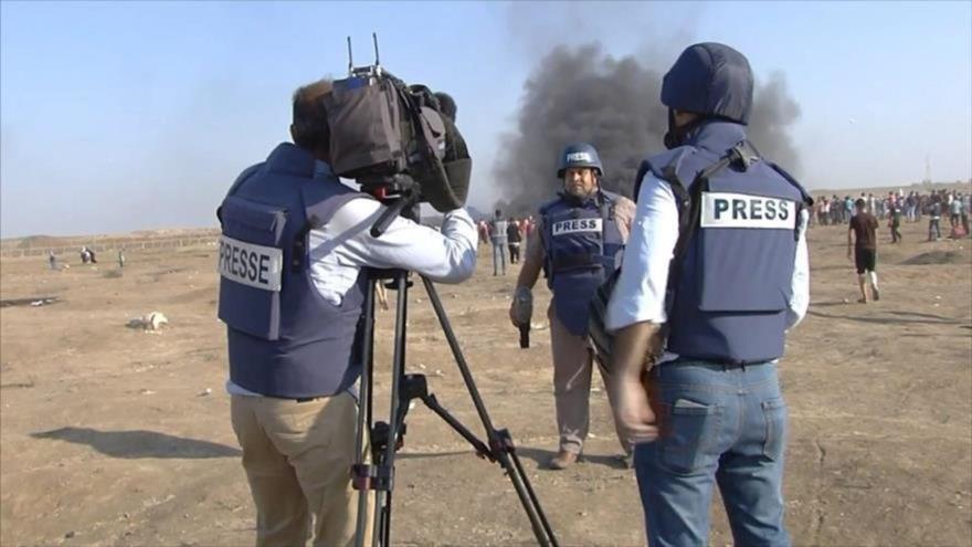 Periodistas palestinos durante la cobertura de las Marchas del Retorno.