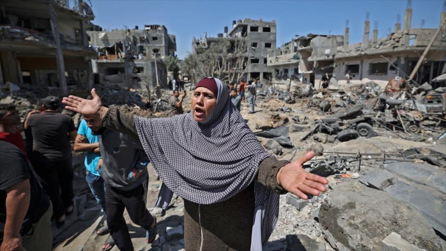 Los palestinos evalúan los daños causados por los ataques aéreos israelíes en Beit Hanun, norte de la Franja de Gaza, 14 de mayo de 2021. (Foto: AFP)