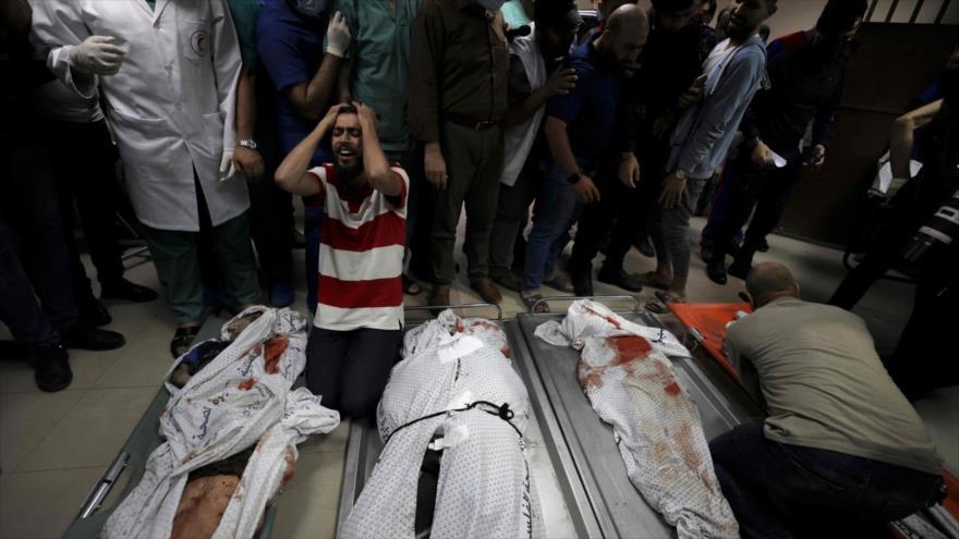 Cuerpos sin vida de palestinos en el hospital Al-Shifa tras un ataque aéreo israelí contra el campo de refugiados al-Shati de Gaza, 15 de mayo de 2021.