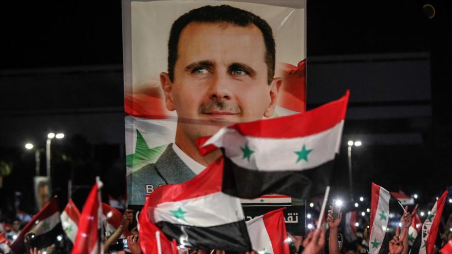 Sirios celebran la victoria de Bashar al-Asad en las elecciones presidenciales, Damasco, 27 de mayo de 2021. (Foto: AFP)