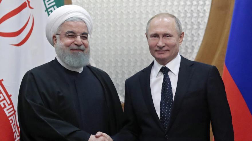 El presidente ruso, Vladimir Putin (dcha.), reunido con su homólogo iraní, Hasan Rohani, en Sochi, en el mar Negro, 14 de febrero de 2019. (Foto: AFP)