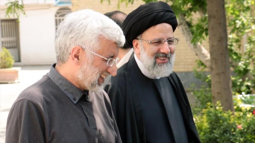 Los candidatos presidenciales de Irán Said Yalili (izq.) y Seyed Ebrahim Raisi (dcha.).