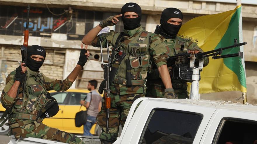 Miembros del Movimiento de Resistencia Islámica de Irak (Kataeb Hezbolá).