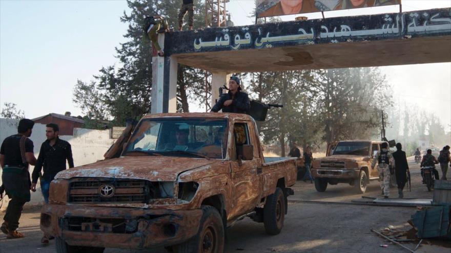 Hombres armados en la provincia de Daraa, Siria. (Foto: Reuters)