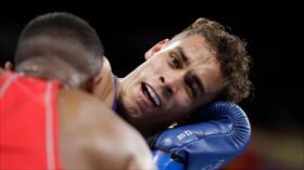 Boxeador pierde JJOO tras intentar morder oreja de su rival