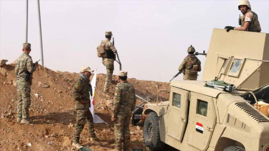 Soldados iraquíes montan guardia cerca de la frontera de Siria. (Foto: AP)