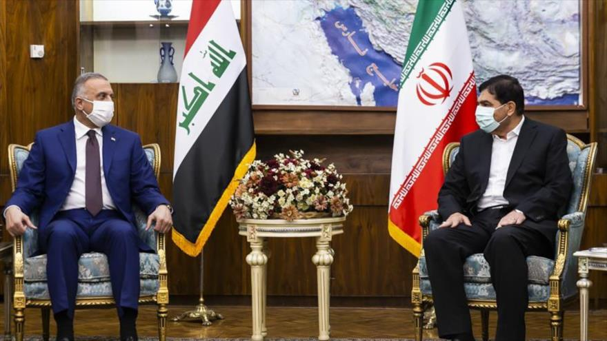 El primer vicepresidente iraní, Mohamad Mojber, y el premier iraquí, Mustafa al-Kazemi, se reúnen en Teherán, capital persa, 12 de septiembre de 2021.