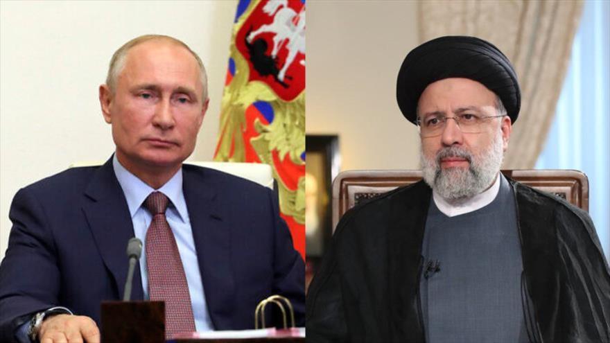 El presidente de Irán, Ebrahim Raisi (dcha.) y su homólogo ruso, Vladimir Putin.