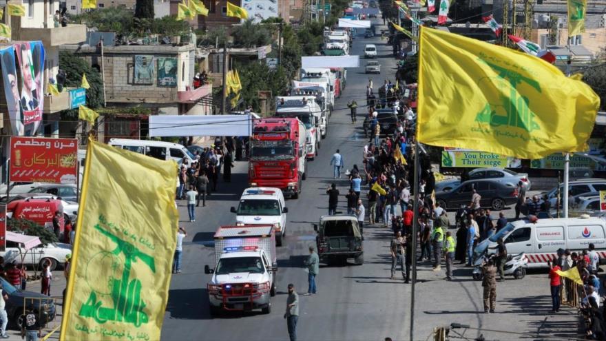 Libaneses celebran llegada de convoy de camiones cisterna con combustible iraní a su país en la ciudad de Al-Ain, 16 de septiembre de 2021. (Foto: Reuters)