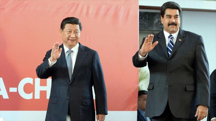 El presidente de Venezuela, Nicolás Maduro, (drcha.) y su homólogo chino, Xi Jinping.