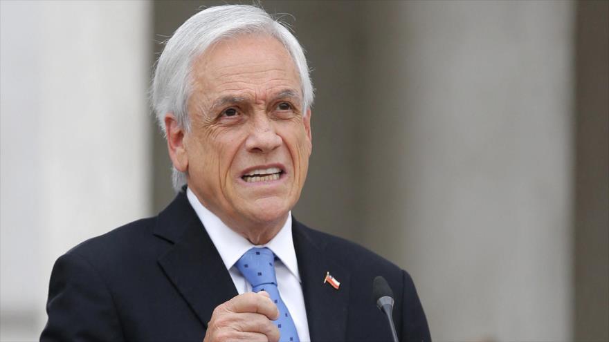 El presidente de Chile, Sebastián Piñera, ofrece una conferencia de prensa en el palacio presidencial en Santiago, 4 de octubre de 2021. (Foto: AFP)